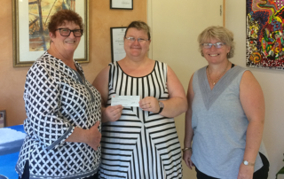 Nambour Apex Club members presenting a cheque to Spiral